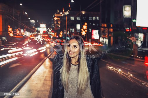 istock Happy girl in middle of traffic 635676266
