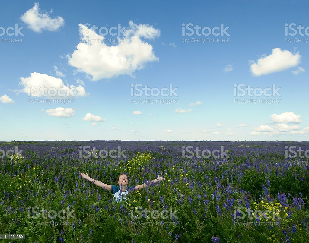 happy girl in the blooming field royalty-free stock photo