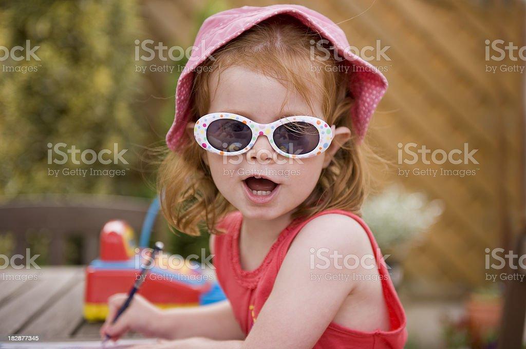 Happy girl in the garden royalty-free stock photo
