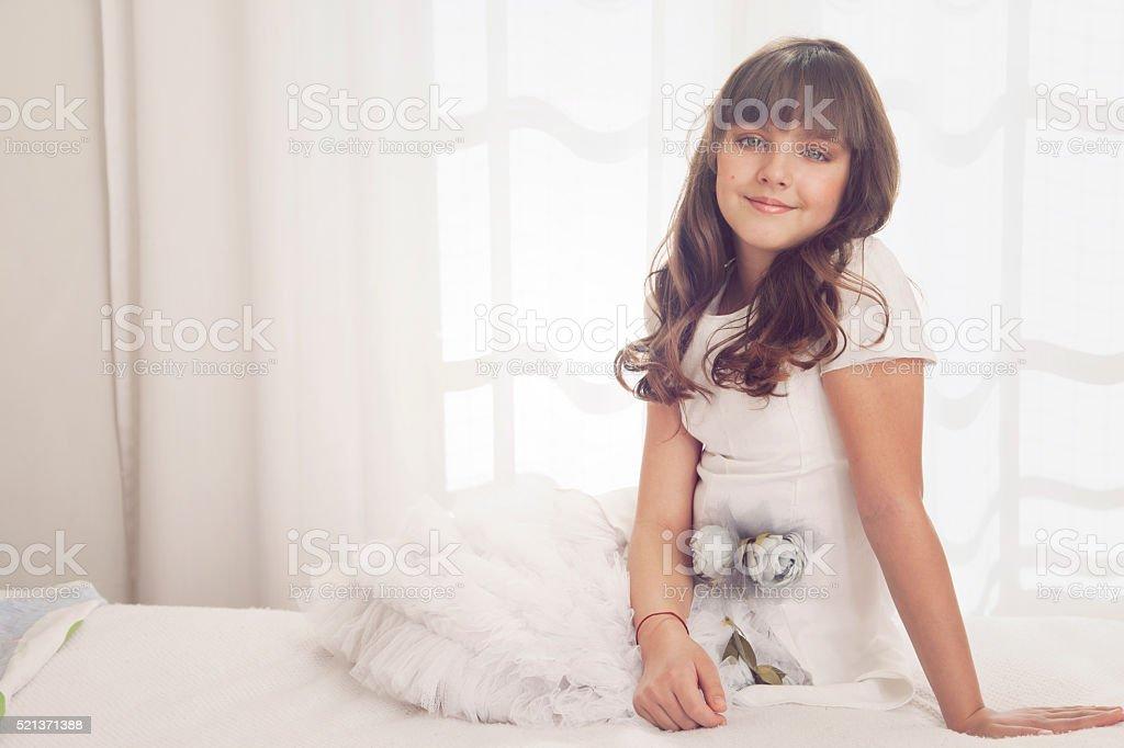 Happy girl in white dress stock photo