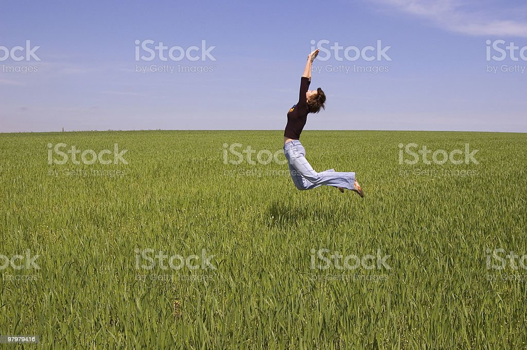 happy girl is jumping on the meadow royalty-free stock photo