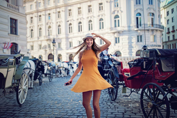 happy girl is walking and dancing on the street - europe travel stock photos and pictures