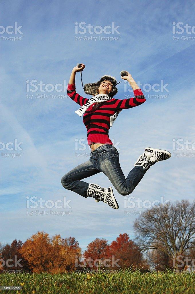 Happy girl jumping of joy royalty-free stock photo