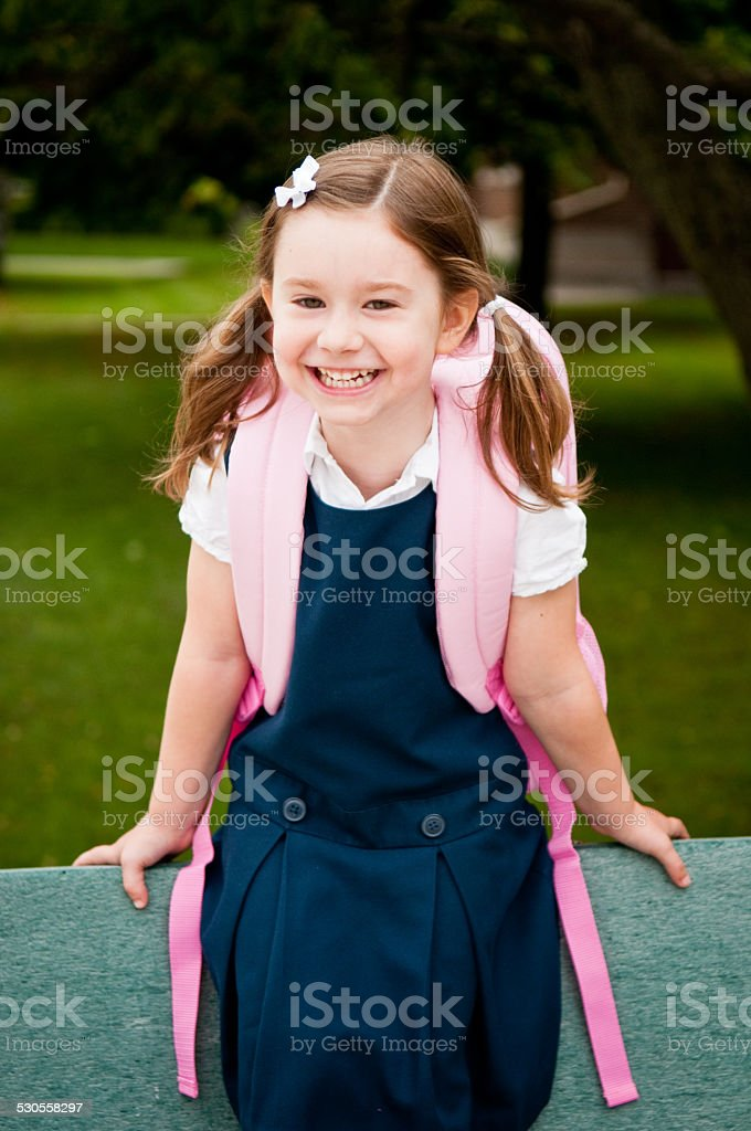 Happy Girl Kindergarten Student on First School Day stock photo