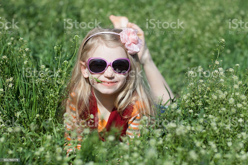 Happy Girl Lay In Grass Stock Photo - Download Image Now ...