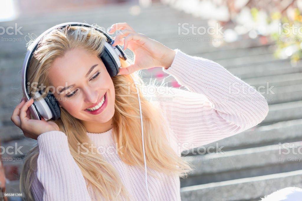 Happy girl listening music with headphones royalty-free stock photo