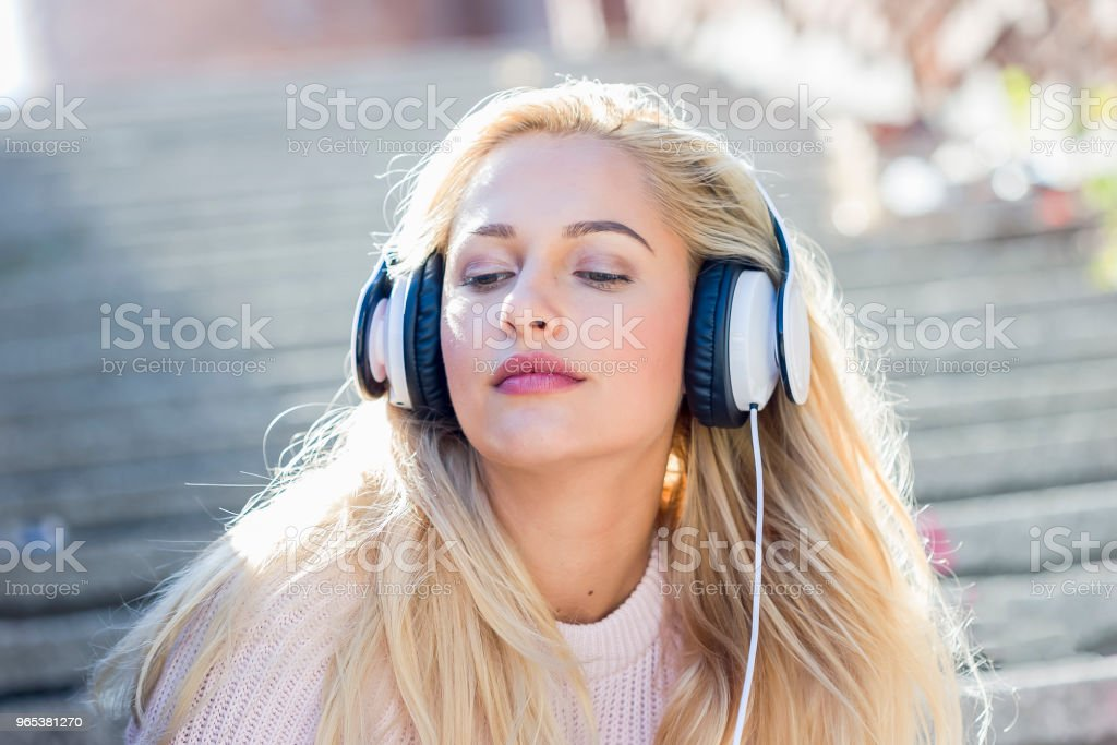 Happy girl listening music with headphones royalty-free stock photo