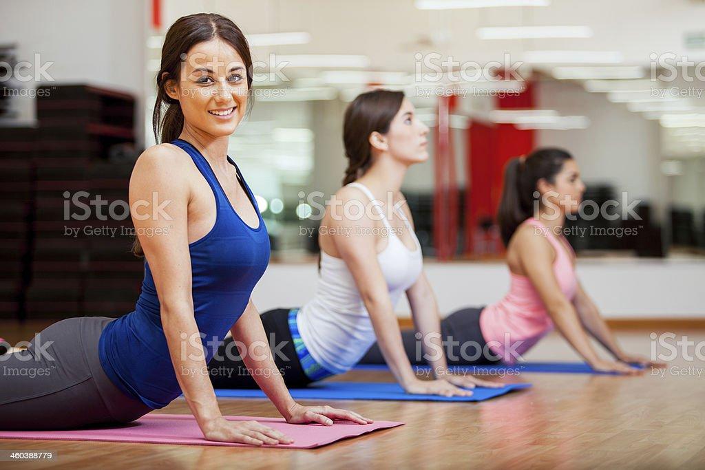 Happy girl loving her yoga class stock photo