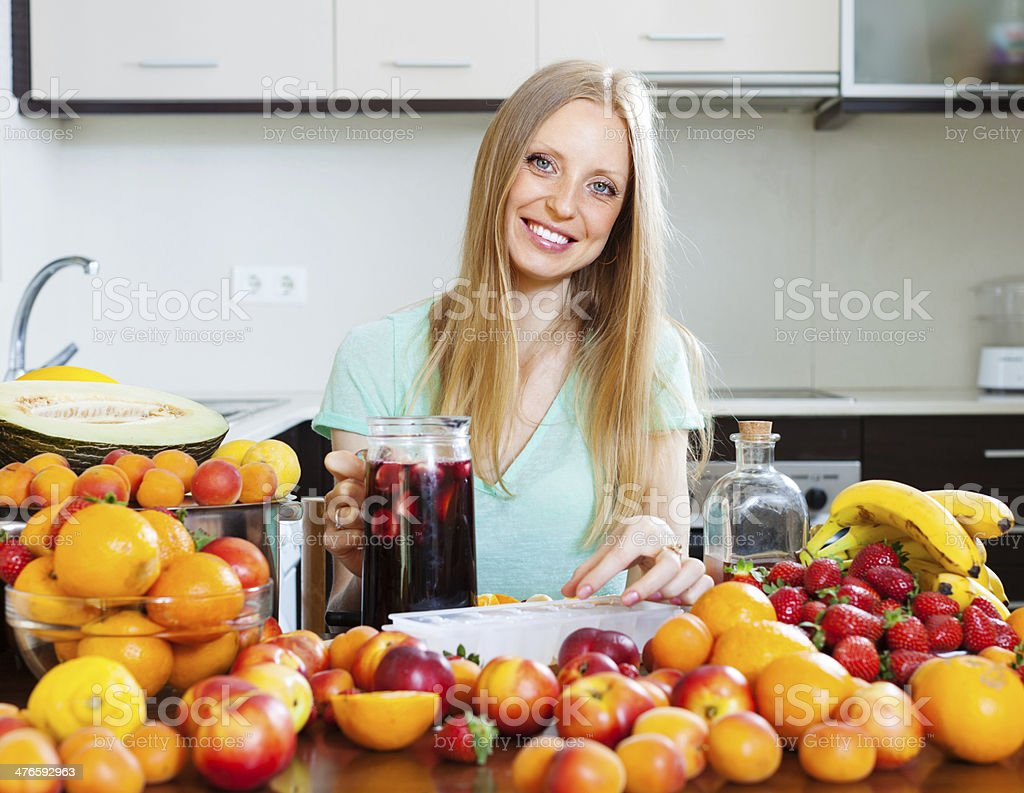 Happy girl making  cocktail royalty-free stock photo