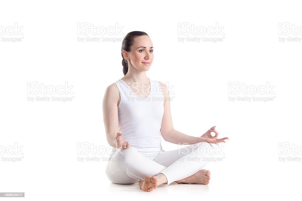 Happy girl meditating stock photo
