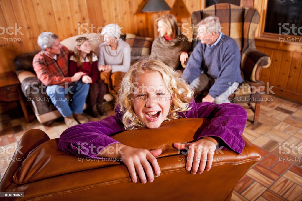Happy girl, multi-generation family in background royalty-free stock photo