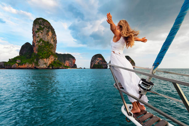 happy girl on board of sailing yacht have a fun. - phuket stock photos and pictures