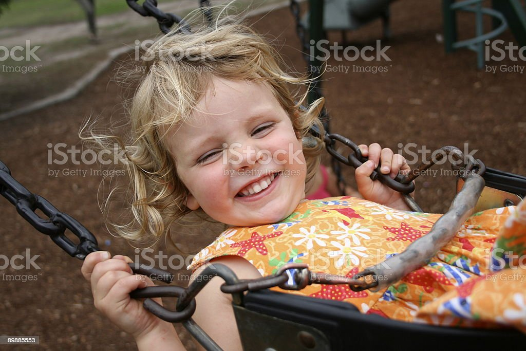 happy girl on swing royalty-free stock photo