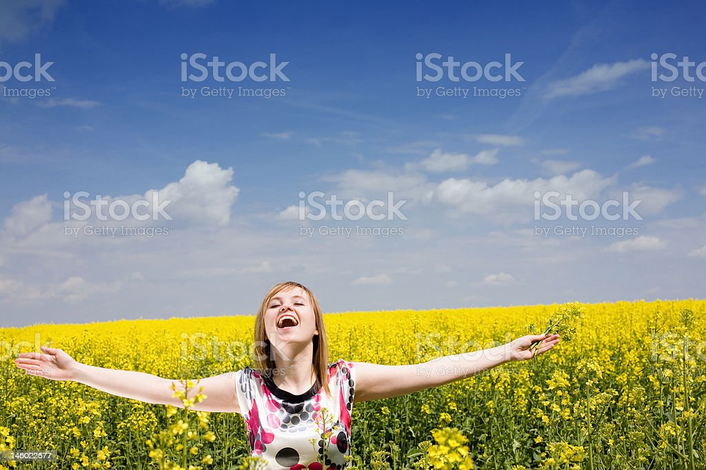 Happy girl on the rape field. royalty-free stock photo