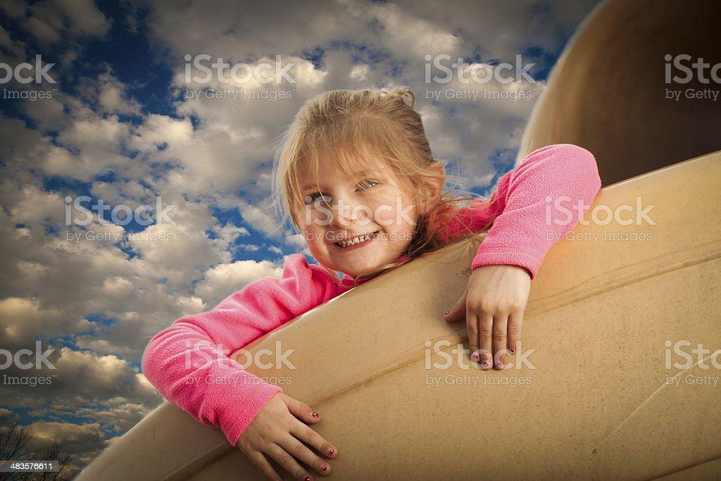 happy girl on the slide stock photo