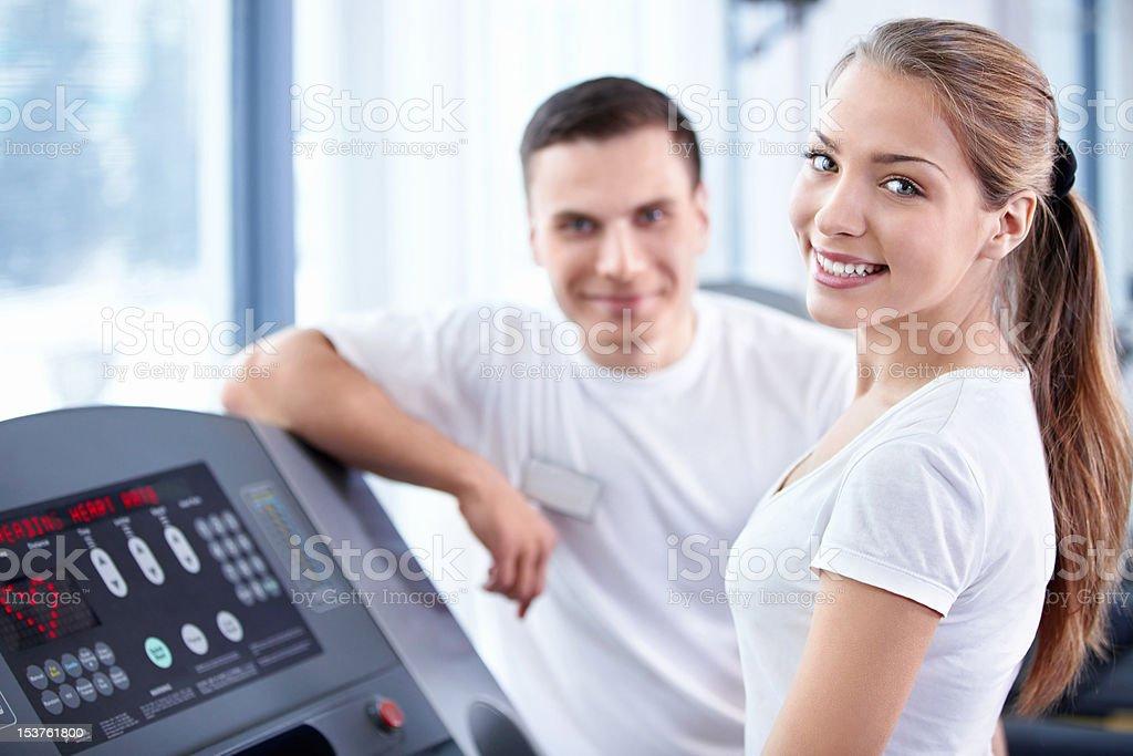 Happy girl on treadmill stock photo