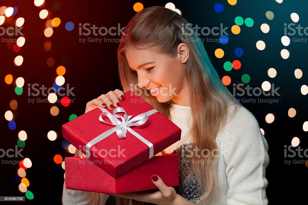 Image result for woman opening christmas gift