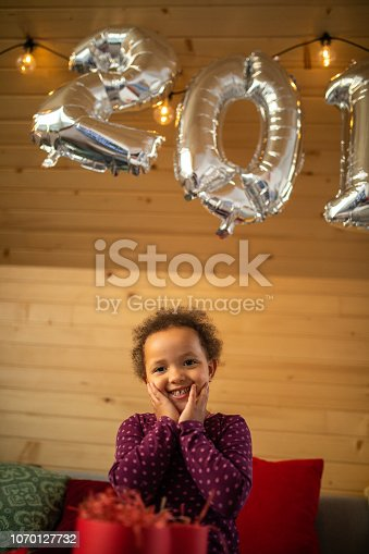 istock Happy Girl Opening New Year's Gift 1070127732