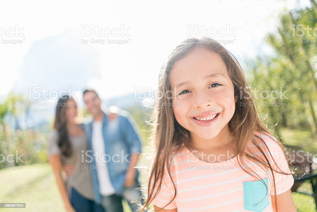 Happy girl outdoors with her family – Foto