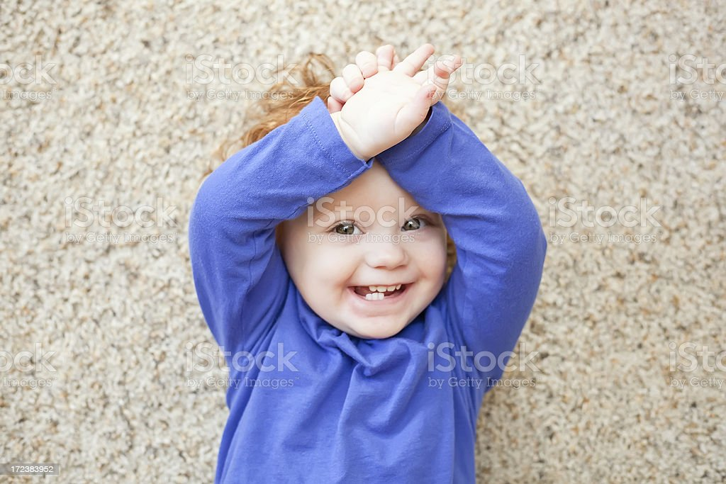 Happy Girl Playing on Floor royalty-free stock photo