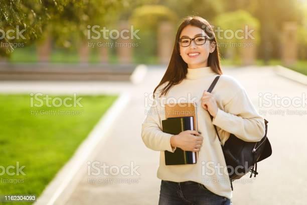 Happy girl posing with backpack carrying books picture id1162304093?b=1&k=6&m=1162304093&s=612x612&h=jgjcm0q aiqja49amgfwy5yuetvn wtbu5usrcs koq=