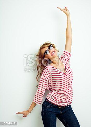 155097509 istock photo Happy girl raising arms 155099441
