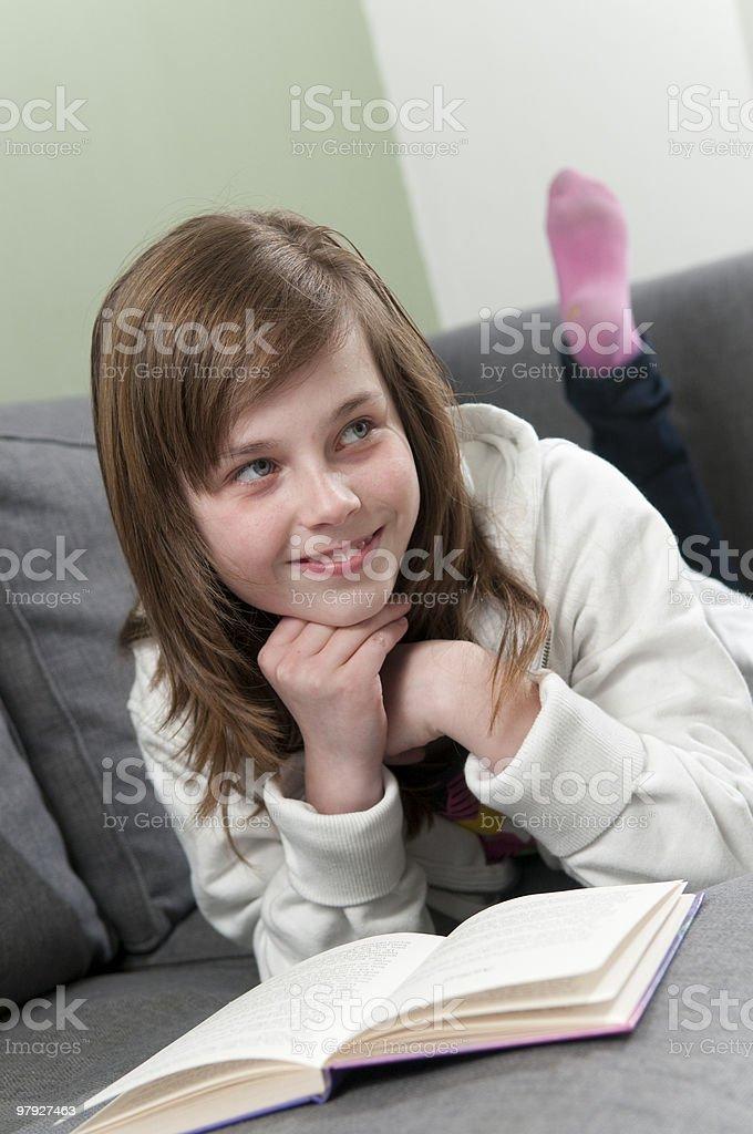 Happy girl reading royalty-free stock photo