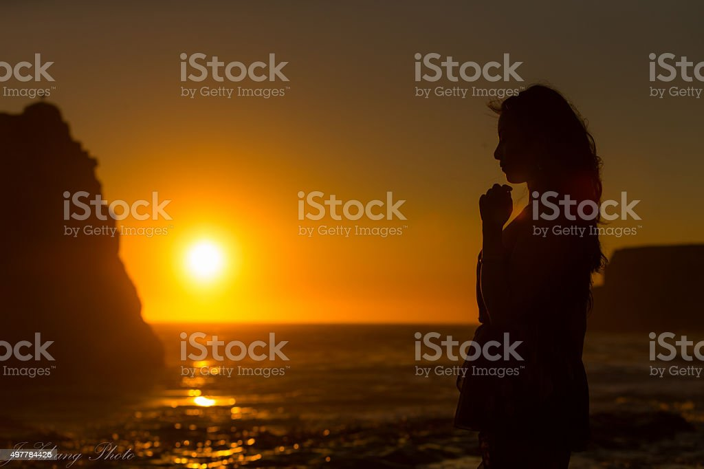 Happy Girl Relax  silhouettes at sunset stock photo