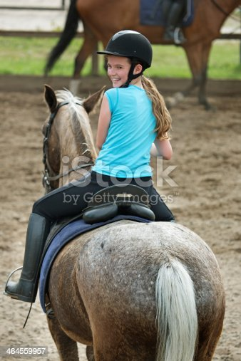 happy girl riding a horse
