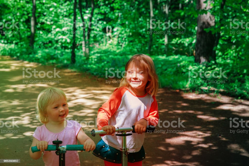 happy girl riding scooters in summer nature royalty-free stock photo