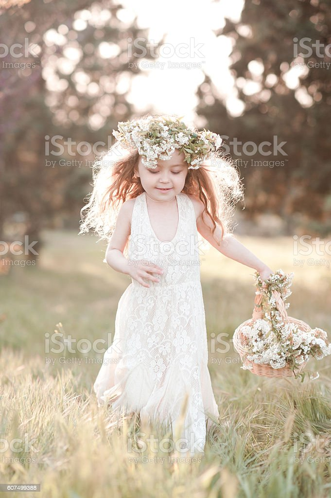 Happy girl running in field stock photo