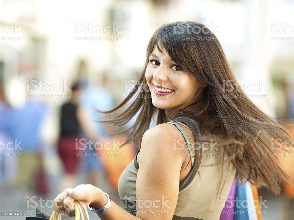 Happy girl shopping in the city stock photo