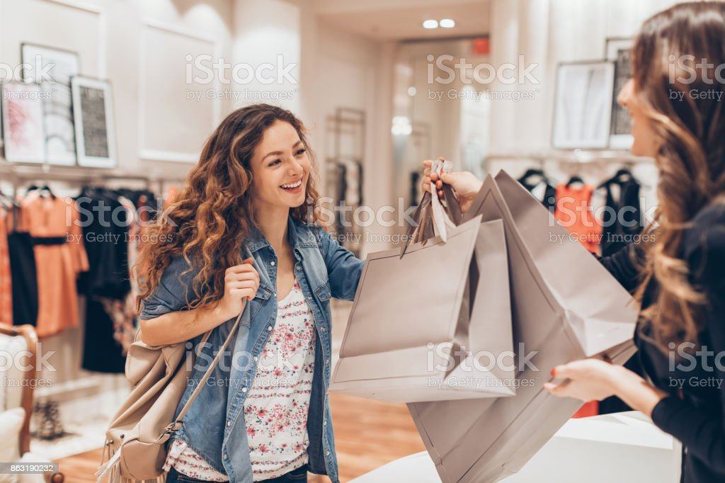 Happy girl shopping in the fashion store stock photo