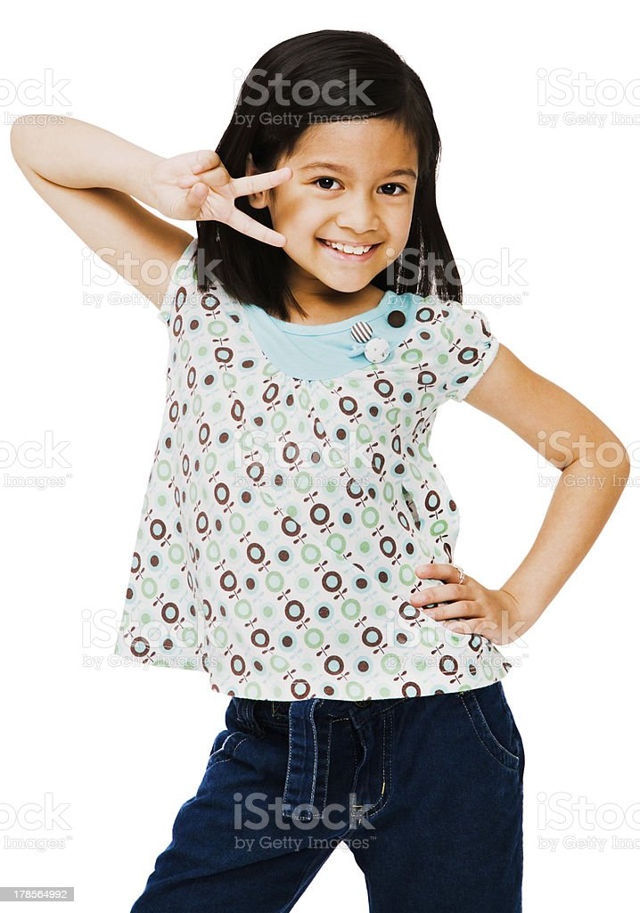 Happy girl showing peace sign stock photo