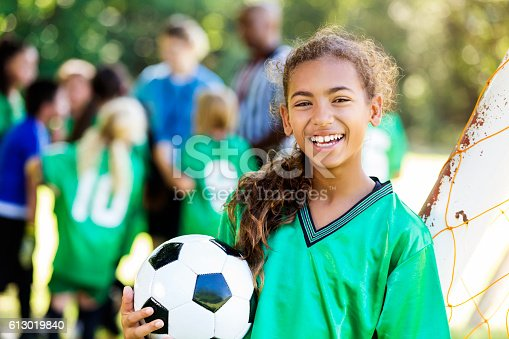 istock Happy girl smiles after winning soccer game 613019840