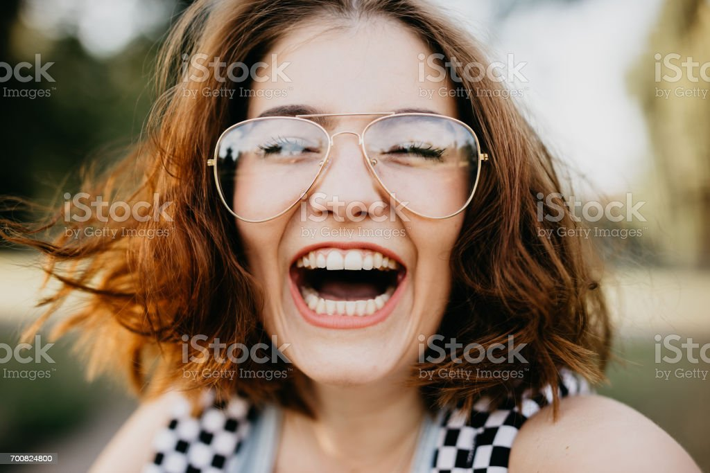 Happy girl smiling at the camera stock photo