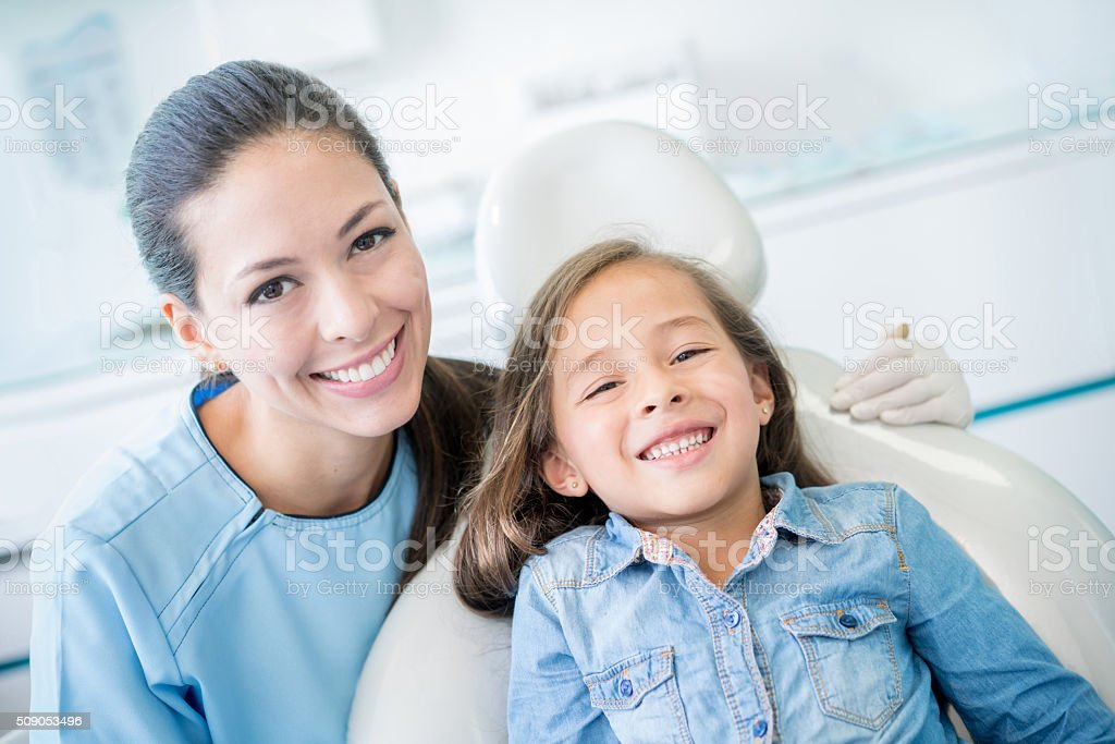 Happy girl smiling at the dentist stock photo