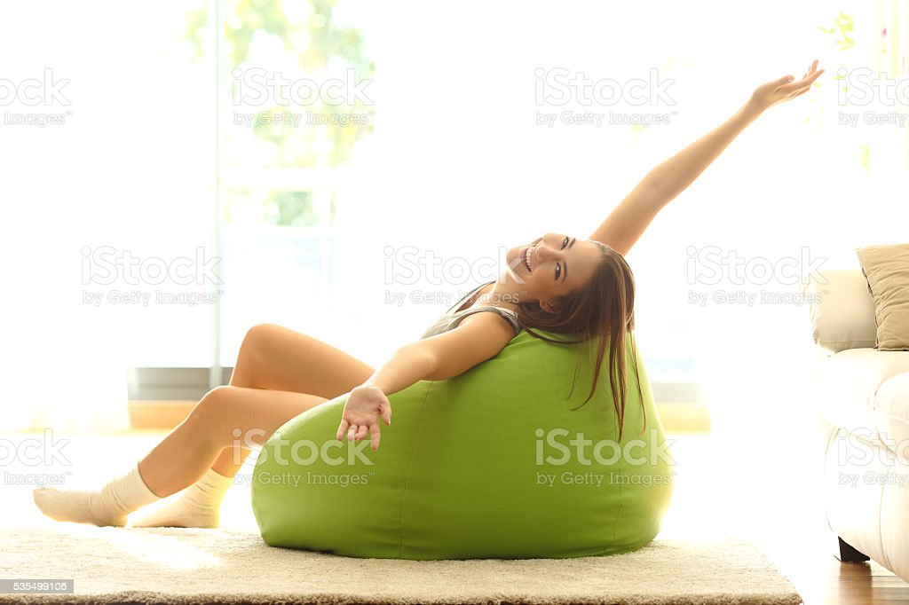 Happy girl stretching at home stock photo