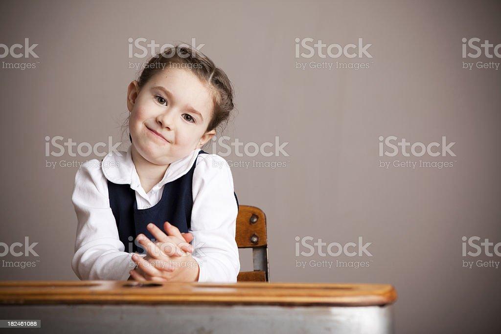 Happy Girl Student Sitting in School Desk royalty-free stock photo