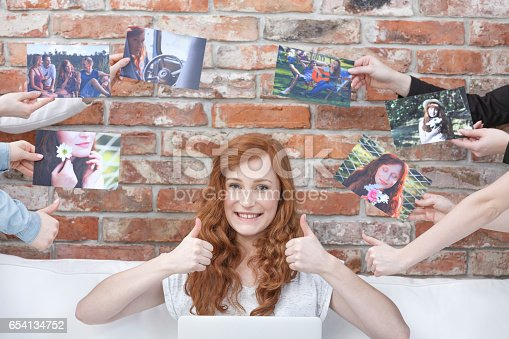 istock Happy girl surrounded by pictures 654134752