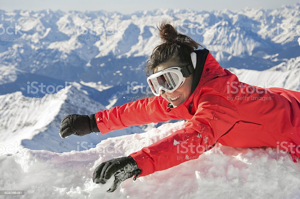 Happy girl waving on the top of a mountain stock photo