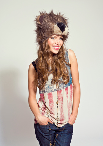 Happy Girl Wearing Fur Hat Stock Photo - Download Image Now