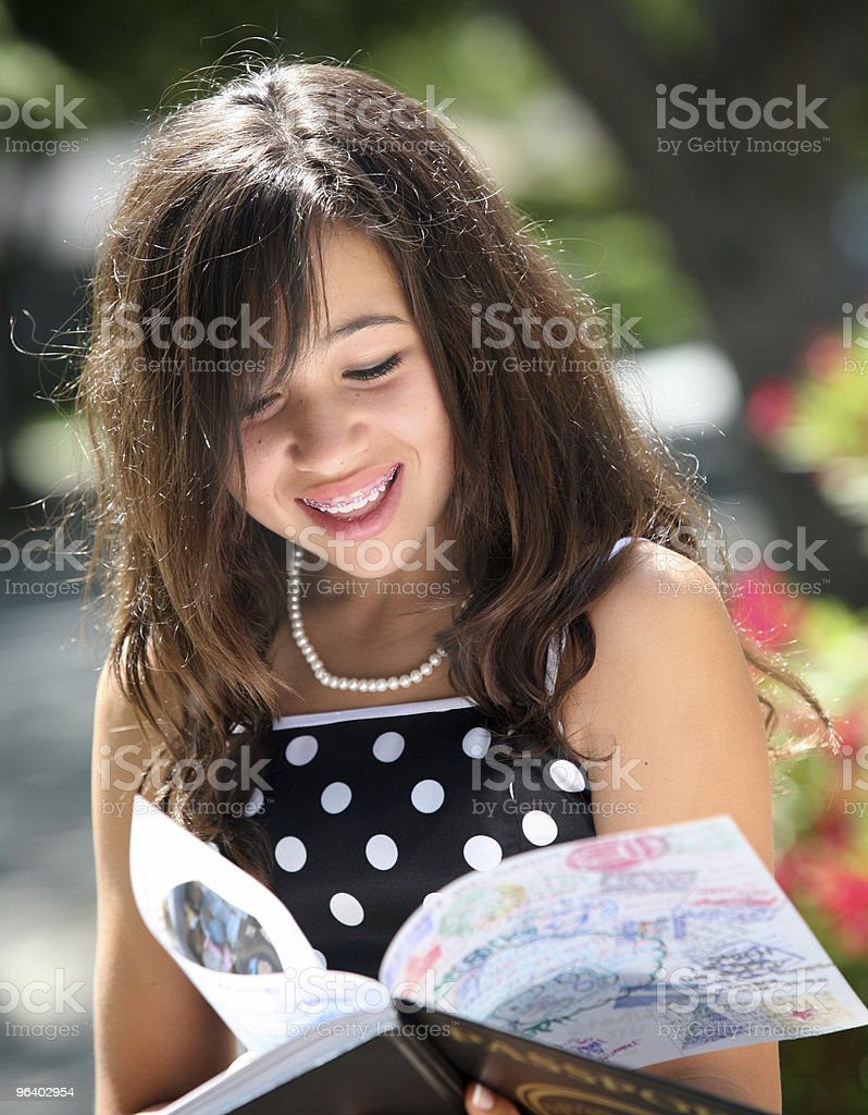 Happy girl with a book - Royalty-free Adult Stock Photo