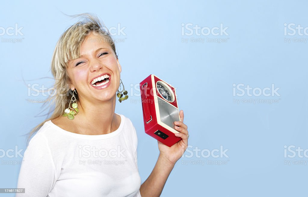 Happy girl with a radio royalty-free stock photo