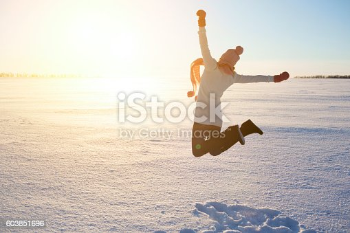 istock Happy girl with a red scarf on the winter 603851696
