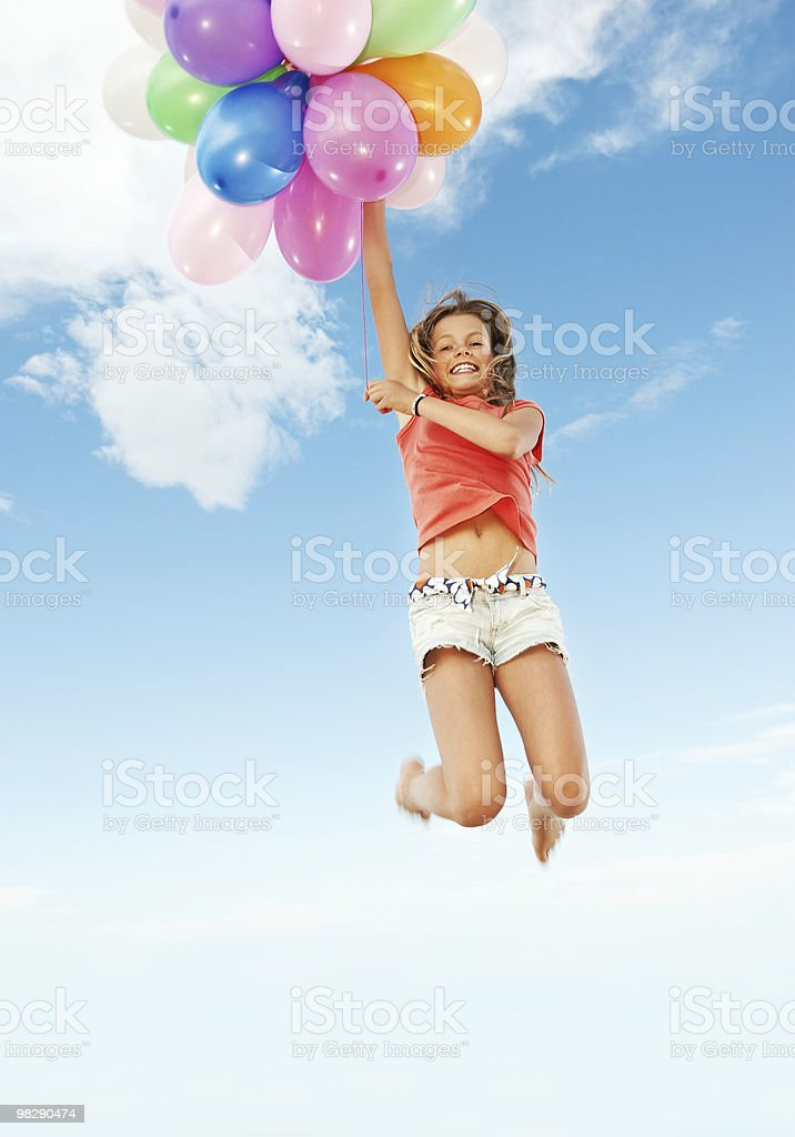 Happy girl with colorful balloons royalty-free stock photo