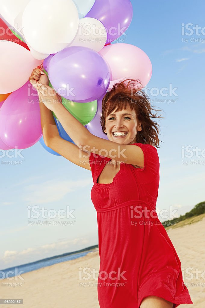 Ragazza felice con palloncini colorati foto stock royalty-free