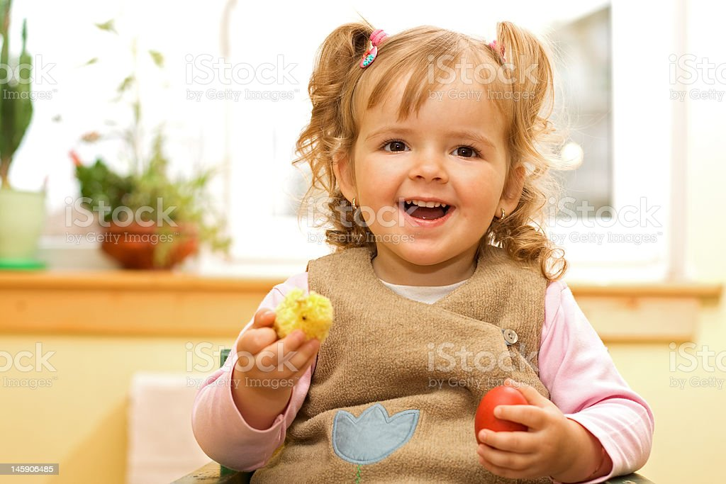 Happy girl with easter egg and decoration in hands royalty-free stock photo
