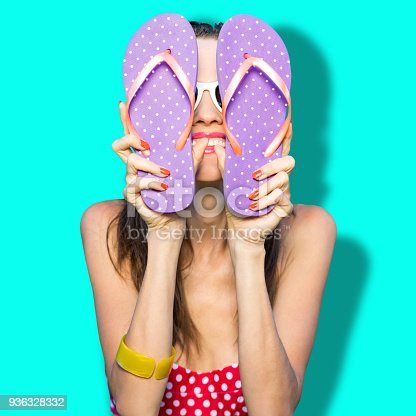 istock Happy girl with flip flops 936328332