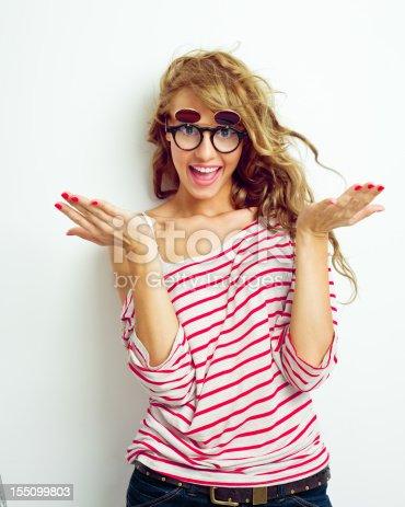 155097509 istock photo Happy girl with funny glasses 155099803